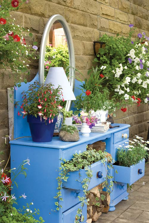 Blue Vanity Table Planted With Flowers