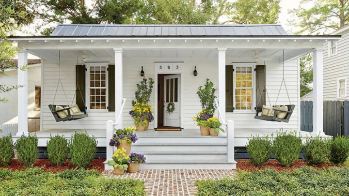Front Porch With Door Framed With Tall Planters