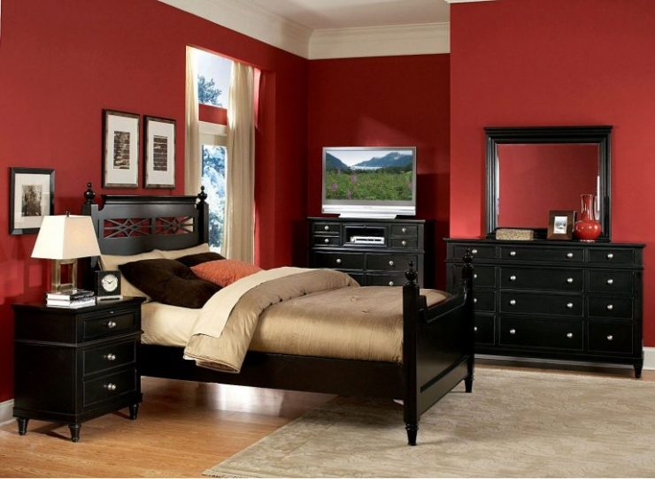 Red Bedroom Walls Offset With Dark Wood Furniture