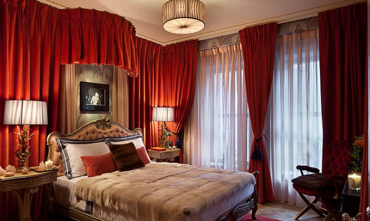 Bedroom With Red Velvet Drapes