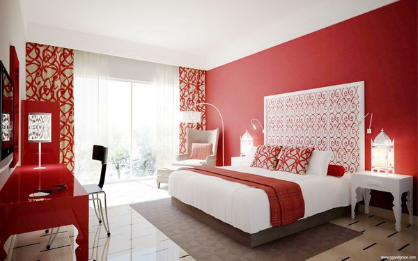 Bedroom With One Red Walls That Picks Up The Colour in Acessories, Furniture, and Drapes
