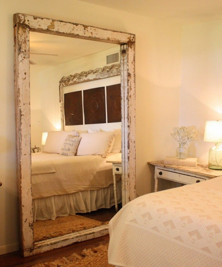 Rustic Bedroom Decoration: Full Length Mirror With a Distressed Wood Frame Leaning Against the Wall
