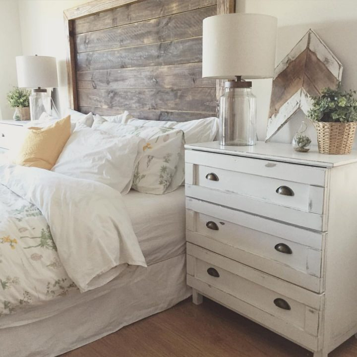 Rustic Bedroom Decoration: an Old White Dresser With Noticable Signs of Wear Re-Used As Nightstand
