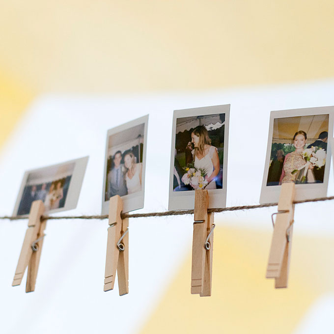Rustic Bedroom Decoration: Photographs Pinned to a String of Yarn With Clothes Pins